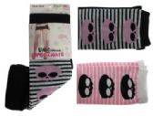 Black, pink and white capri tights with skull and stripes designs.