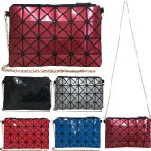 Vibrant geometric print cross body bag with removeable chain.