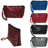 Spider weave design wristlet / cosmetic bag with removeable wristlet in vibrant material.