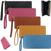 Women's wristlet wallet crafted in a rich faux ostrich.