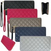 Women's wristlet wallet crafted in a fashion forward quilted faux leather Isaabella