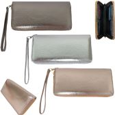 Women's wristlet wallet in neutral metallic faux leather.
