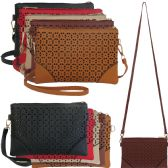 Horizontal cross body bag with laser cut out design in faux leather.